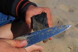 How To Sharpen A Knife - Rubbing on stone will sharpen the knife